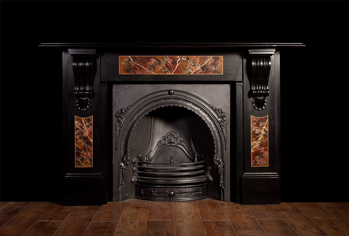 A Large Victorian Black Slate Fireplace With Coloured Marbleized Panels