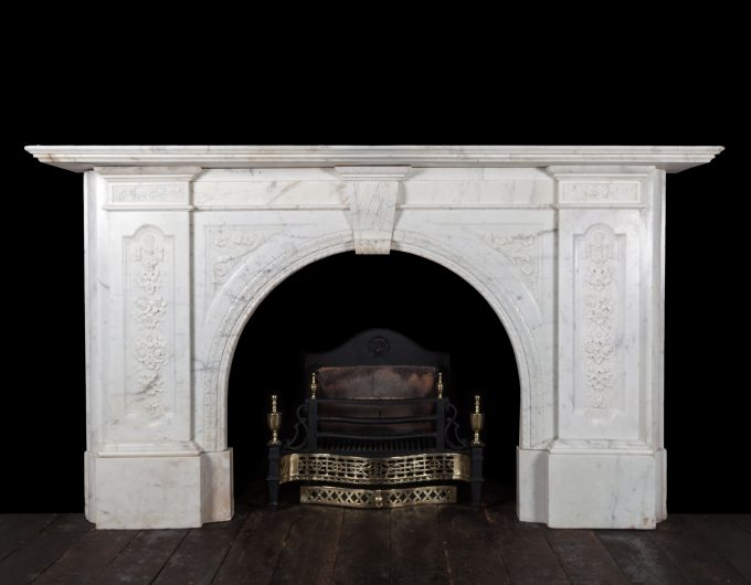 Antique carved march arch fireplace